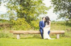 The bride and the groom sharing a kiss. Michigan outdoor wedding at Misty Farms.