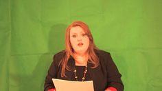 Sylvia Dennis playing a news anchor.