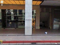 That's right - a baby, alone, outside of a Gucci store...