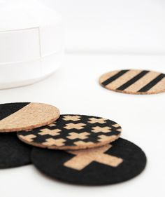a graphic stencil and a little black paint transform these cork coasters into something special
