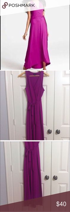 Pink Magenta Ann Taylor Small Petite Maxi Dress Beautiful magenta pink Ann Taylor Maxi dress, Small Petite. Never worn NWOT. Such a great color for all seasons. V-neck with a tie at the waist. 94% rayon and 6% spandex. Ann Taylor Dresses Maxi