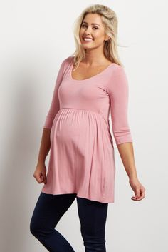 This 3/4 sleeve maternity top is the perfect sleek and stylish basic. The 3/4 sleeves make this a versatile piece for warm or cool weather. Cinching under the bust flatters your figure. Easy to wear with your favorite pair of jeans.