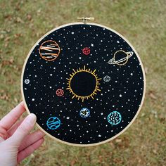 Our very own Solar System is stitched by hand in this celestial embroidery hoop art. The Earth and all of our neighboring planets orbit the Sun against the black background of space and stars. Framed in an 8 wooden hoop, ready to ship! The embroidery you receive may vary slightly from