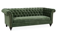 Clad in button-tufted velvet upholstery in a vibrant, forest green hue, this sumptuous sofa delivers stylish color and contrast to your space. Two cushy throw pillows and a generous...