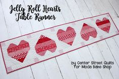 Hi! This is Kristina Brinkerhoff from Center Street Quilts and I'm excited to share a Valentine's Day project with you today: Jelly Roll Hearts Table Runner! I enjoy working on holiday projects, bu