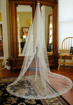 My veil from The Mantilla Company. Cathedral length Spanish veil in ivory