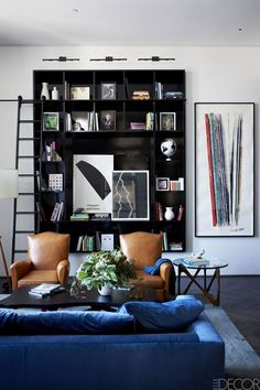 blue, black, and cognac colored living room