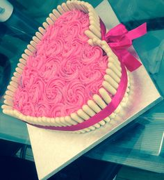 Heart shape white chocolate finger cake and rose swirl icing :)))