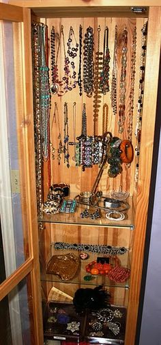 Turn a curio cabinet into jewelry storage.