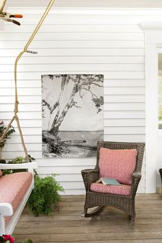 You can easily create a whole new view from your porch. Upload your favorite snapshot (we like megaprint.com) and have it printed on weather-resistant vinyl. The banner comes to you complete with grommets for hanging.   - ELLEDecor.com