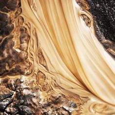 Photographs of sand in water by Sylvain Meyer