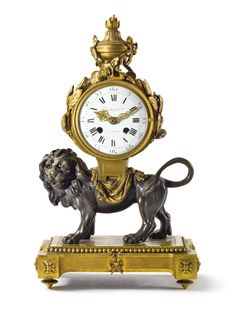 Property from the Estate of Brooke Astor  A Louis XVI style gilt and patinated bronze mantel clock Late 19th/Early 20th Century, the dial signed Lieutaud Hger. A Paris