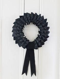 Black crepe paper streamer wreath - Outdoor Halloween Decorations - Halloween Outdoor Decor - Country Living