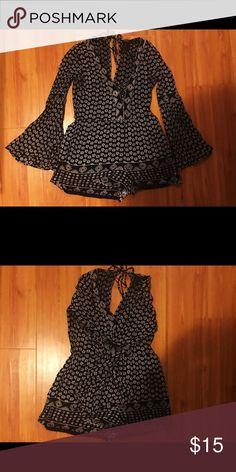 Long-sleeved patterned romper Black and white patterned romper. Tied in the back. Like new! Forever 21 Dresses Long Sleeve