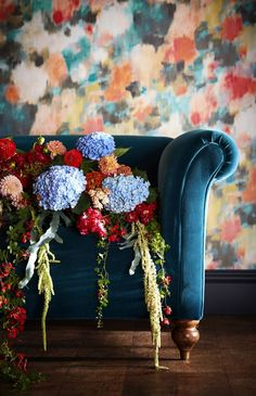 A wallpaper design of obscure blooms in a dragged stripped watercolour effect, creating a glorious explosion of colour to your room.