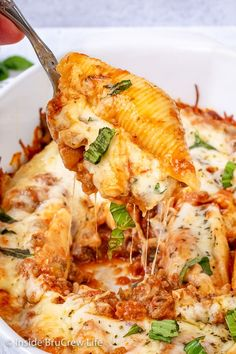 Classic Stuffed Shells - a creamy three cheese filling and meat sauce makes this comfort food taste amazing. Make this easy recipe for dinner or freeze for later. Stuffed Shells With Meat, Cheese Stuffed Shells, Stuffed Shells Recipe, Pasta Dishes, Food Dishes, Main Dishes, Meat Recipes, Pasta Recipes, Chicken Recipes