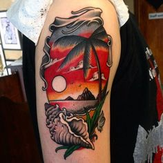 Male Neo Traditional Upper Arm Sunset Tattoo With Shell And Palm Tree