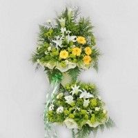 White Lily And Yellow Gerbera Arranged In Metal Stand