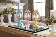 """H213812 Set of 3 9"""" Eggs on Pedestals with Bunny Design. H197823 Beveled Glass MIrror Centerpiece. H214485 3pc Multi Berry & Leaves Rings. H207986 Set of 3 Graduated Candle Holder Pedestals."""