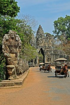 http://www.greeneratravel.com/ house's cart at South gate of Angkor thom, Siem Reap City, Cambodia