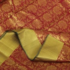 You will want this pure zari Sarangi creation—it's an elegant, picturesque tribute to flowers done in the complementary palette of red and green, rendered satiny and lavished with pure zari gold. The body teems with large, starkly outlined flowers, woven in gold, while the green-gold pallu is resplendent in its zigzag and floral motifs. Needless to say, nature is beautifully imagined and transformed in this gorgeous sari.Code 110113478