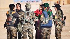 #Media #Oligarchs #MegaBanks vs #union #occupy #BLM #SDF #Humanity   #InternationalWomensDay YPJ fighters distribute red roses in the villages of Raqqa they liberated from Islamic State (ISIS) - #Rojava #Syria   https://twitter.com/KurdishQuestion/status/839754476420497408