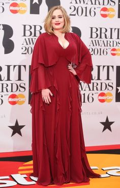 Adele's red dress at the Brit Awards 2016. Photos Red Carpet Outfits, Style and Fashion Looks.