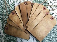 antiqued tags by using a blend of coffee, cinnamon and vanilla-I've been wanting tags like this for a while now!