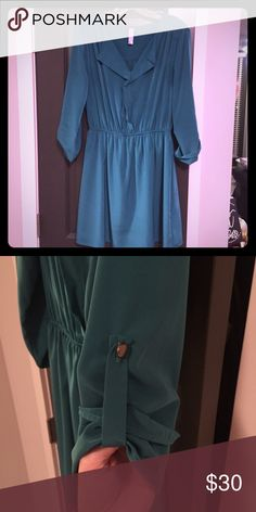 """Teal shirt dress sz M Bought from a boutique, this adorable dress is perfect with tights and boots for the fall/winter and can be dressed up or down! Size M with an elastic waist, 35"""" long from shoulder to hem. Has roll up sleeves with gold button detail Francesca's Collections Dresses Long Sleeve"""