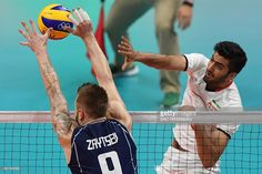 Iran's Amir Ghafour spikes the ball during the men's quarter-final volleyball match between Italy and Iran at Maracanazinho Stadium in Rio de Janeiro on August 17, 2016, during the Rio 2016 Olympic Games. / AFP / Eric FEFERBERG