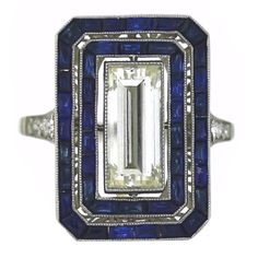 Vintage Jewelry Art Deco Diamond and Sapphire Ring - The ring is made in platinum with a center stone that features a beautiful carat baguette cut diamond. The sapphires weigh approximately carats. This ring is sizable to any size. Anel Art Deco, Art Deco Schmuck, Bijoux Art Nouveau, Art Deco Ring, Art Deco Jewelry, Fine Jewelry, Stylish Jewelry, Sapphire Jewelry, Sapphire Earrings