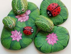 Ladybugs and Frogs painted rocks look so realistic.