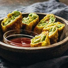 These avocado egg rolls are fried to crispy perfection and served with a tasty sweet chili sauce. This recipe is vegetarian and a crowd favorite!