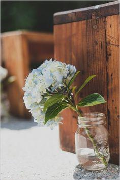 hydrangea bloom and mason jar aisle decor