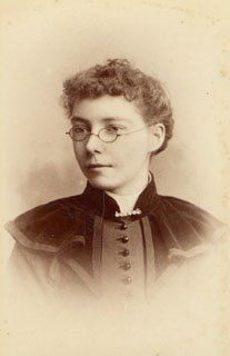 1890s Fashion: If this woman were older she could be Miss Prism....