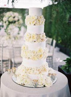 Gorgeous towering floral-filled cake: http://www.stylemepretty.com/2016/02/04/black-tie-secret-garden-wedding/ | Photography: Jose Villa - http://josevilla.com/