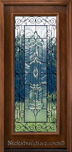 Iron classic door - This is a pretty door - the glass detail is amazing & detailed- the iron classic design, is sandwiched in-between 2 pieces of smooth glass making is an easy clean :) bought only at www.nicksbuilding.com  #woodenfrontdoors #exteriordoorswithglass  #elegantentrydoors Exterior Doors With Glass, Wood Exterior Door, Exterior House Colors, Sliding Glass Door, Exterior Paint, Main Entrance Door, Entry Doors, Main Door, Wooden Front Doors