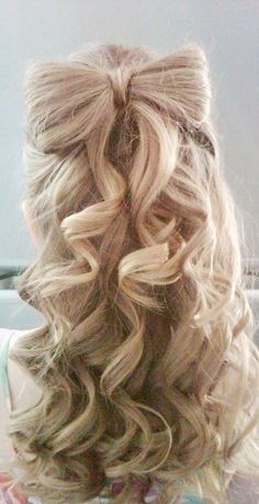 Curly Bow Hairstyle hair prom updo bun curly hair hairstyles wedding hairstyles prom hairstyles