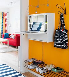 A wall-mount desk also works well in an entryway or mudroom. You can rest your laptop or tablet on the flip-down desk to do last-minute e-mails and schedule or weather checks as you're heading out the door. The cubbies can house pens and paper for jotting notes.