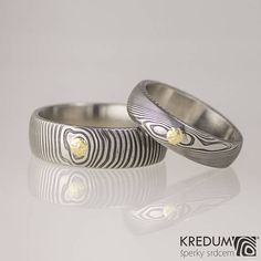 DAMASCUS steel WEDDING band with a GOLD, unique simple womens and mens band, Engagement ring,gift for her, him - Prima with a gold adornment. These rings are made of damascus stainless steel DAMASTEEL and are complemented with 14 carat gold circles.