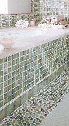 Mix up basic tile work with contrasting textures in the same color family
