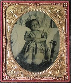 A 1/6 plate ambrotype below is of a small girl propped up in a chair. This and the patterned curtain behind her suggest that it was made in the home and not a studio.