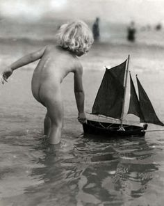 Playing with toy sailboat, 1932~♛