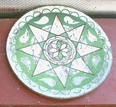 This hex sign has a green five-pointed star and pictures of various animals. Another meaning of stars is protection, so I am guessing that this sign is for protection of the animals. The orange is for abundance and the green is for fertility.