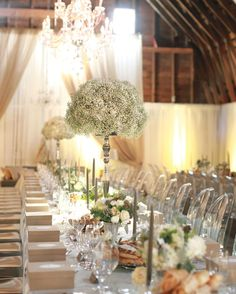 After the ceremony, a band led everyone to the barn, where boxes of French macarons waited at guests' seats. The reception vibe was created with rustic elements that were offset by elegant touches: Tall tapers stood in antique candleholders, and baby's breath was used en masse for a dramatic effect.