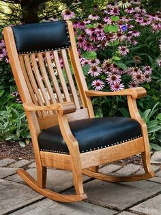 Amish Made Maybury Black Leather Upholstered Rocking Chair in Quarter Sawn White Oak Wood OCS 113 Michaels Cherry Delightful, luxurious and oh so comfortable. The Maybury lets you lean back and rock a bit in exquisite comfort. Custom rocker made in America. Choose wood, stain and upholstery for yours. #rockers #livingroomchairs Amish Rocking Chairs, Upholstered Rocking Chairs, Amish Furniture, Rustic Furniture, Furniture Making, Living Room Seating, Living Room Chairs, How To Varnish Wood, Quarter Sawn White Oak