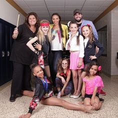 Dance moms photo shoot ok I'm so sick and tired of this why is nia bottom again is she even supposed to be in this picture? Wow abby ok ur done I hate u I don't like u anymore. Why is nia at bottom oh ok let me guess because she's black ok u know what abby watch ur back one more problem and aww I'm so mad I can't even explain<- she's probably at the bottom because she's portraying a gymnast so a split is a clever pose