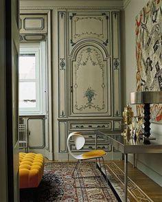 In this 1920s Milan apartment, a saffron-hued chair by 21st-century designer William Sawaya takes center stage.
