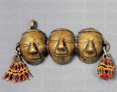India - Nagaland | Man's necklace pendant; depicting faces and decorated with coloured beads. Worn by Konyak and Wancho headhunters | Private collection. Image ©De Agostini / A. Dagli Orti