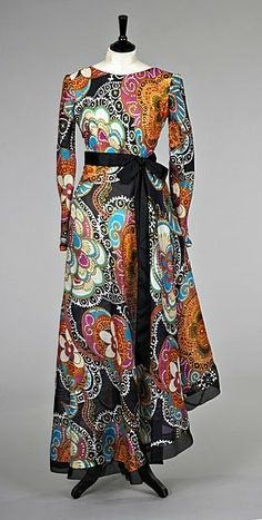 Pierre Balmain psychedlic printed organza evening gown, circa 1970, labelled and numbered 151443, with black satin ribbon sash to waist boat-neckline and low back.